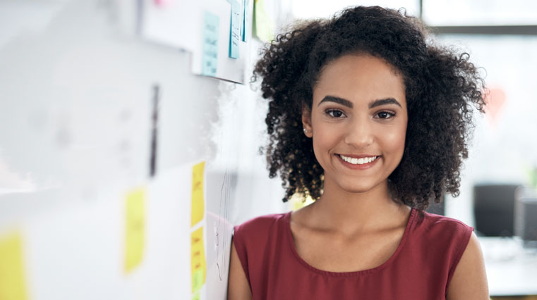 smiling women leaning on dry erase board